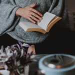 grey sweater girl with book